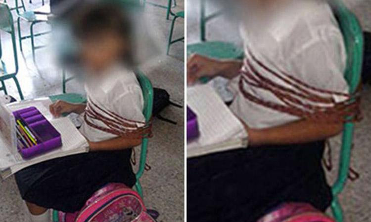 เด็กนักเรียนถูกจับมัดติดเก้าอี้